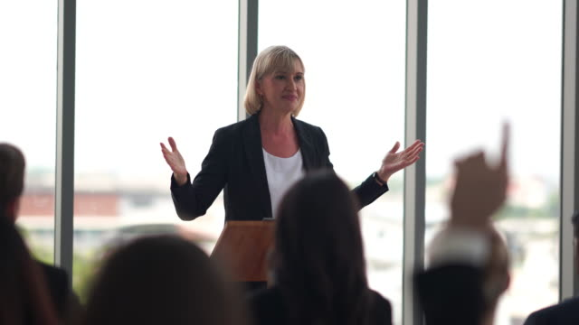 business women attending a seminar and speaking at business conference room - large group of people stock videos & royalty-free footage