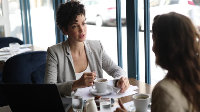 business women having meeting at cafe - lunch break stock videos & royalty-free footage