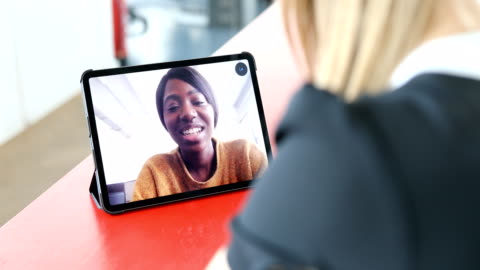 business women making a video call - video call stock videos & royalty-free footage