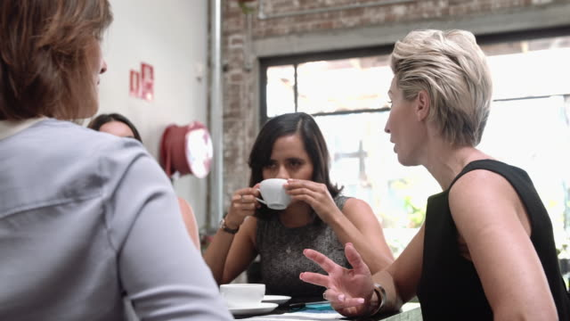 Business women meeting in a cafe