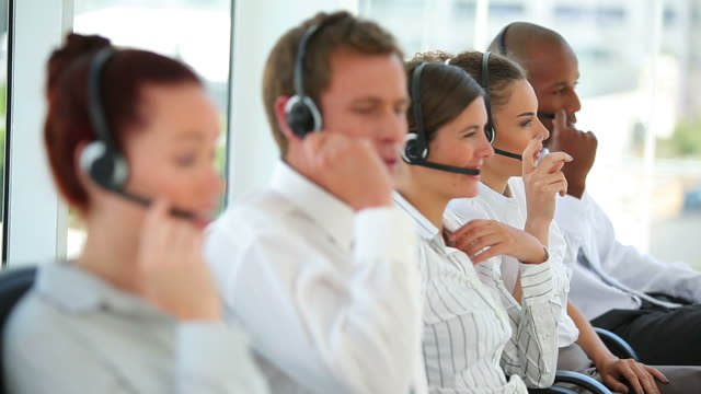 Business workers talking on headsets