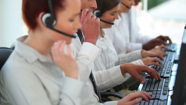 vídeos y material grabado en eventos de stock de business workers talking on headsets - camisa y corbata