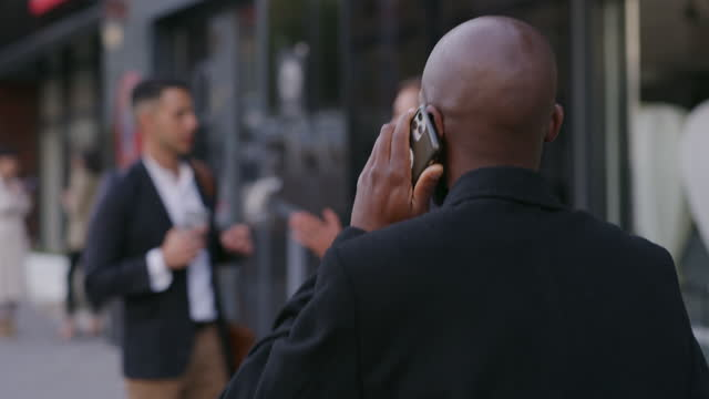 vídeos de stock e filmes b-roll de business works the more you network - atrás