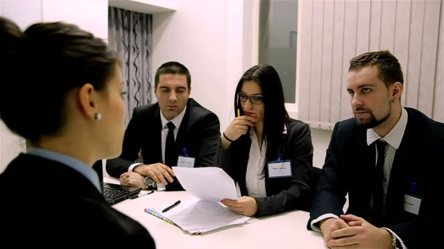 Business - young woman  sitting in job Interview
