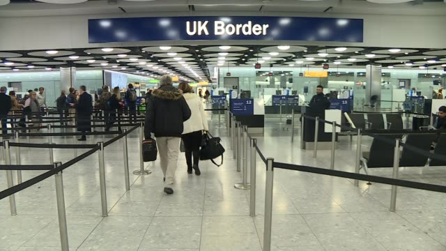 Businesses criticise visa 'hostile environment' Heathrow Airport INT Various of UK Border Control Passports being scanned at passport control