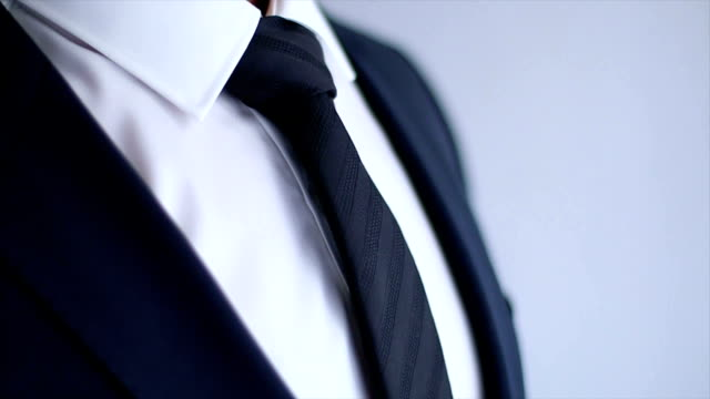 businessman adjusting his necktie - suit stock videos and b-roll footage