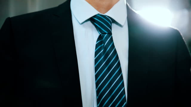 businessman adjusting tie - necktie stock videos & royalty-free footage