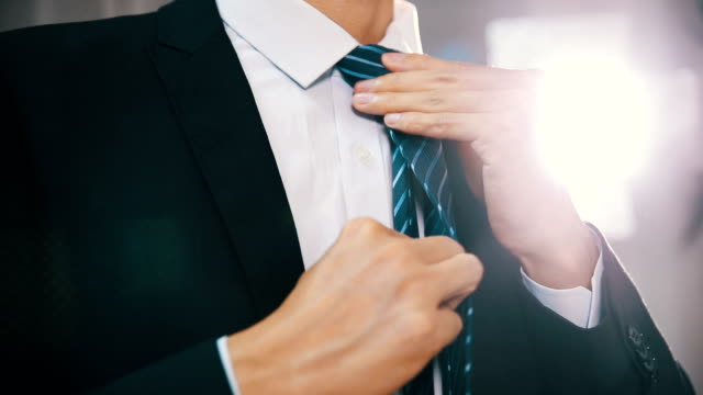businessman adjusting tie - tie stock videos & royalty-free footage