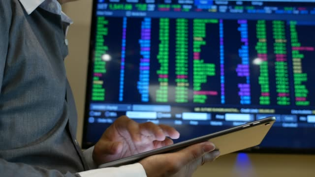 businessman analysis stock market data with digital tablet and laptop in office - market trader stock videos & royalty-free footage
