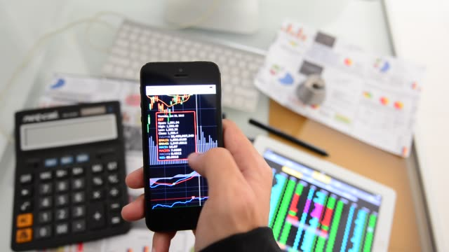 Businessman analysis stockmarket with digital tablet and laptop in office