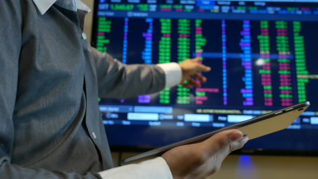 Businessman Analyzing Stock Market Data with Tablet PC