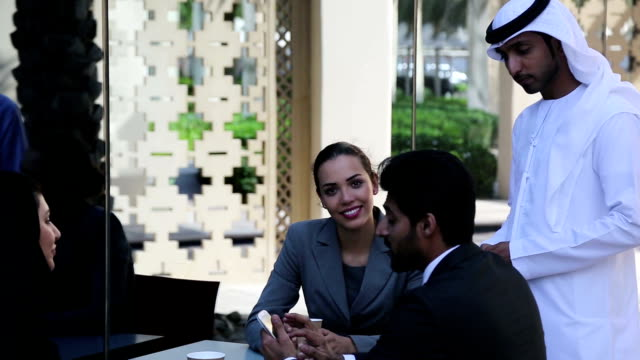 Businessman and Business woman discussing on the table