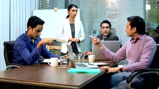 Businessman and businesswoman discussing, Delhi, India