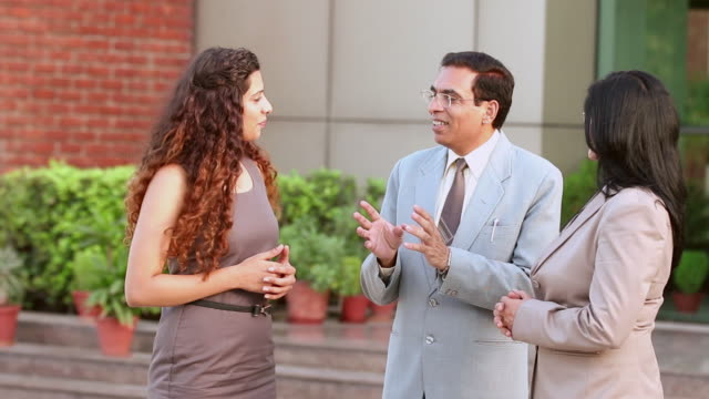 businessman and businesswoman discussing, noida, uttar pradesh, india - neckwear stock videos and b-roll footage