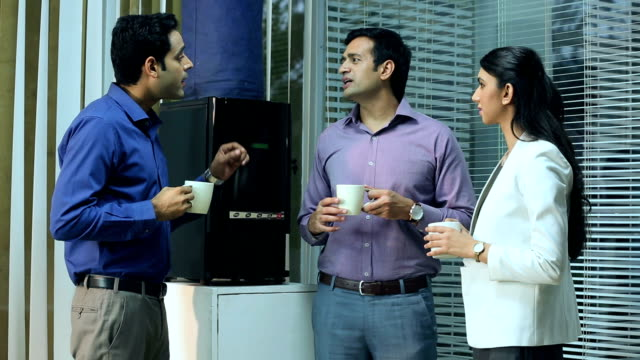 businessman and businesswoman drinking tea, delhi, india - employee engagement stock videos & royalty-free footage