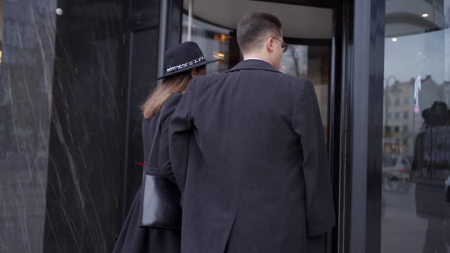 businessman and businesswoman entering the hotel - entrance stock videos & royalty-free footage