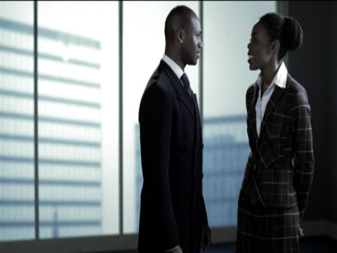 Businessman and Businesswoman Flirting in an Office