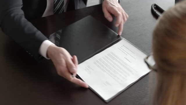 businessman and businesswoman signing a contract - signing stock videos & royalty-free footage