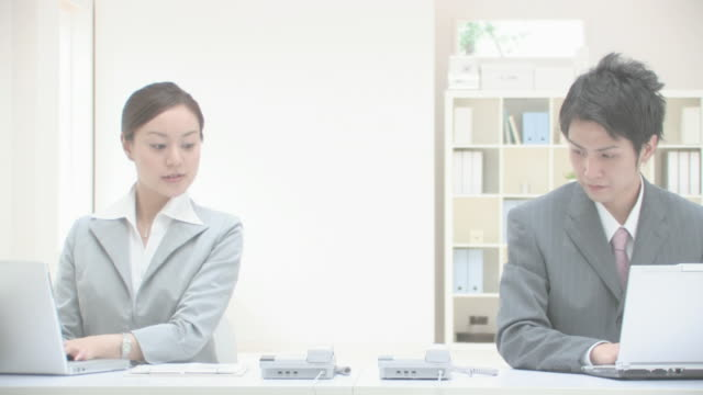 businessman and businesswoman working in office - only japanese stock videos & royalty-free footage