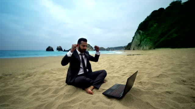 Businessman and Computer on the Beach - 4K Resolution