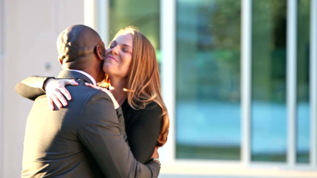 businessman and wife meeting outside office building - wife stock videos & royalty-free footage