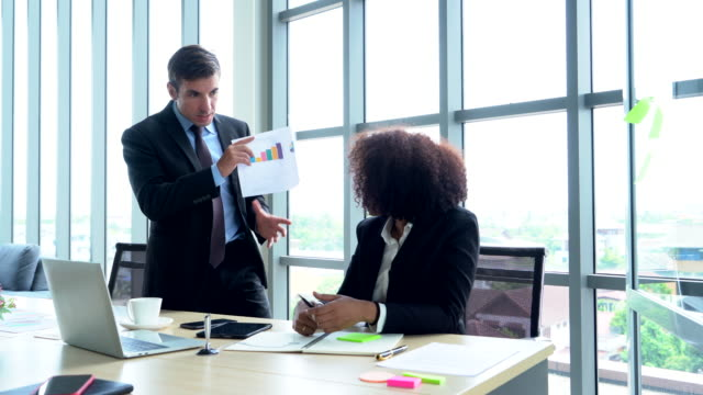 businessman and woman having conflict at workplace - bossy stock videos & royalty-free footage