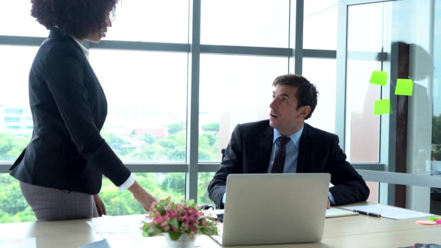 businessman and woman having conflict at workplace - displeased stock videos & royalty-free footage