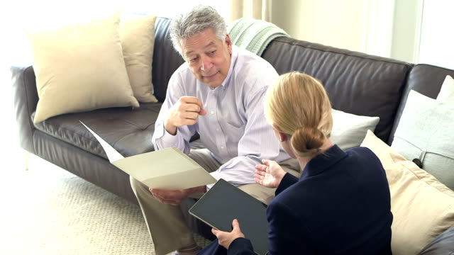 Businessman and woman having discussion