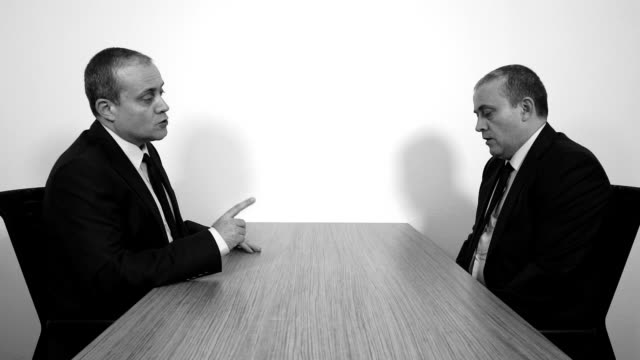 Businessman Arguing with Himself (Black And White)
