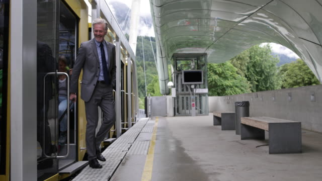 Businessman arriving at airport on shuttle train