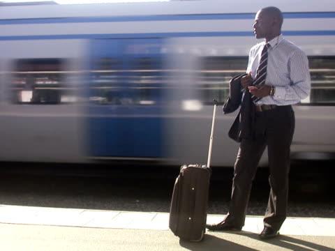 A businessman at a train station Stockholm Sweden.