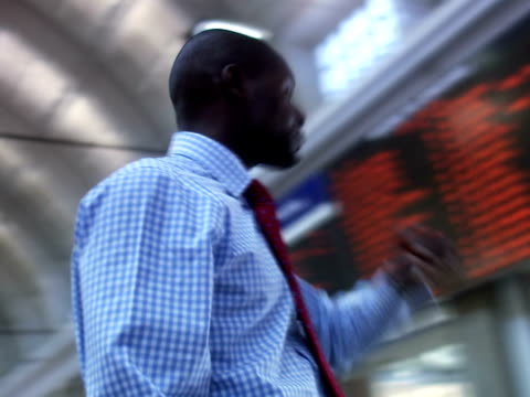 a businessman at a train station stockholm sweden. - only mid adult men stock videos & royalty-free footage