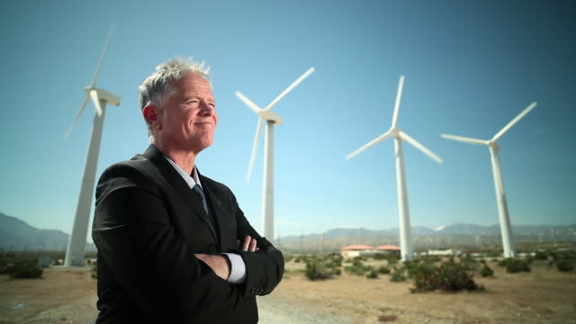 businessman at a windfarm - authority stock videos & royalty-free footage