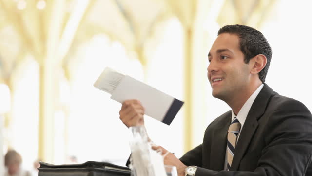 Businessman at airport ticket counter
