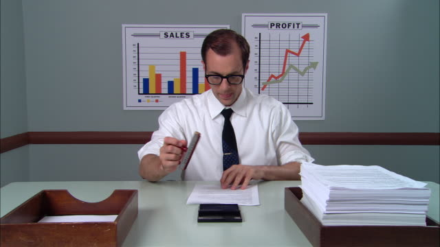 ms businessman at desk rolling up sleeves and beginning to stamp stack of papers, moving them from inbox to outbox/ new york city - sleeve stock videos & royalty-free footage