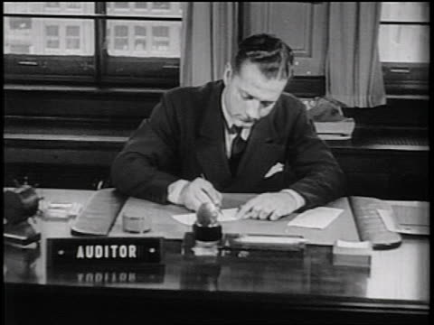 b/w 1936 businessman at desk writing check at desk + placing it in envelope / documentary - pen stock videos & royalty-free footage