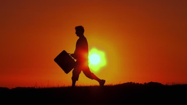 HD SLOW-MOTION: Businessman At Sunset