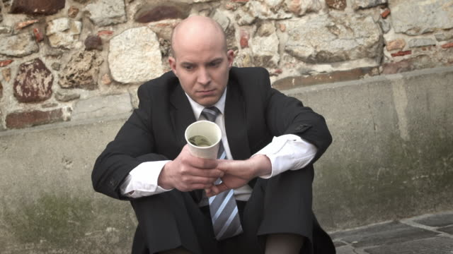 hd dolly: businessman begging on the street - completely bald stock videos and b-roll footage