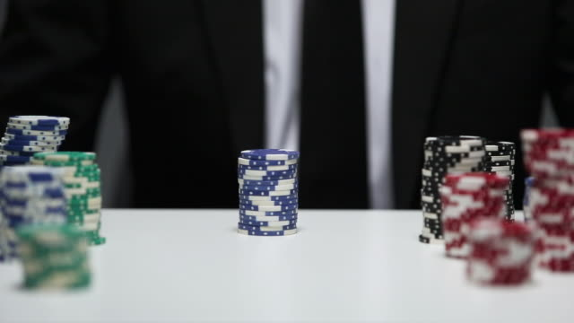 businessman betting poker chips in the game - gambling chip stock videos & royalty-free footage