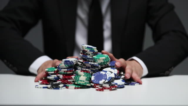 businessman betting poker chips in the game - gambling chip stock videos and b-roll footage