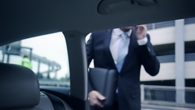 Businessman boarding car