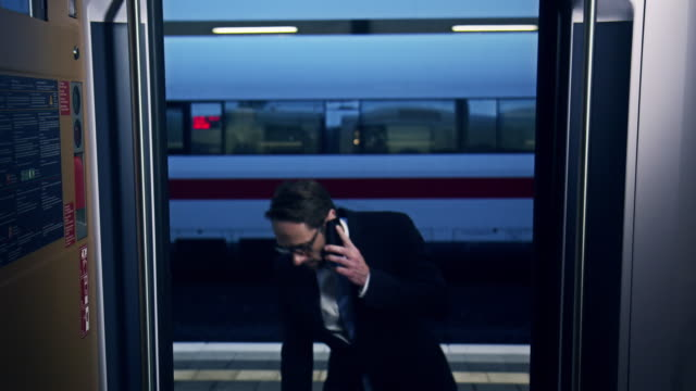 businessman boarding train - getting on stock videos & royalty-free footage