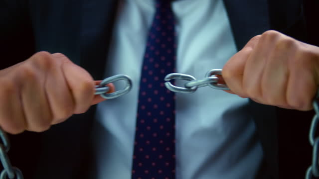 slo mo ld businessman breaking a chain - chain stock videos & royalty-free footage