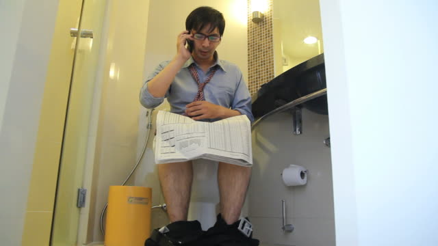 hd : businessman busy work in toilet - toilet stock videos and b-roll footage