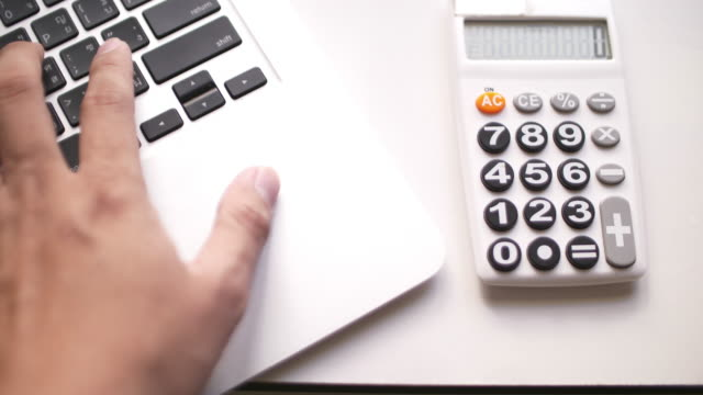 businessman calculating in office - home economics class stock videos & royalty-free footage