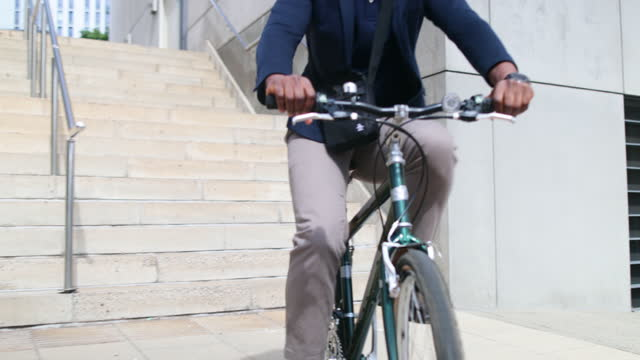 businessman carrying his bicycle down stairs - formal businesswear stock videos & royalty-free footage