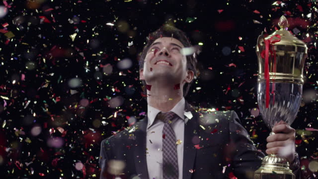 businessman celebrating success with holding a trophy  - cup stock videos & royalty-free footage