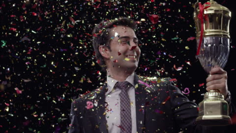 businessman celebrating success with holding a trophy  - award stock videos & royalty-free footage