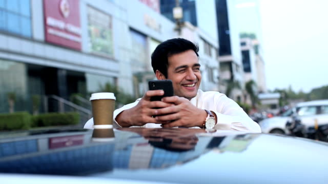 businessman chatting on mobile phone, delhi, india - indian subcontinent ethnicity stock videos and b-roll footage