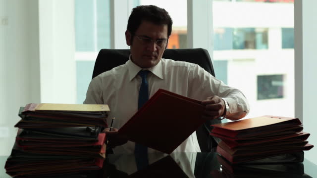 businessman checking file in an office  - file stock videos & royalty-free footage
